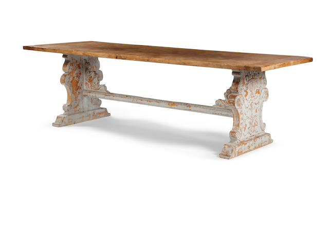 A pine and painted trestle table In the 16th century Tuscan manner