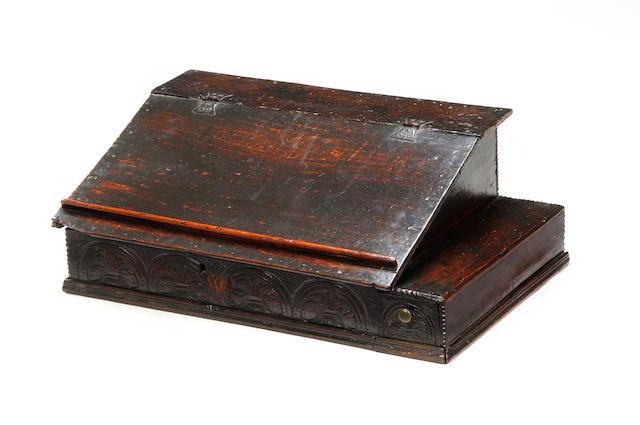An unusual Charles II oak boarded desk box, with side drawer