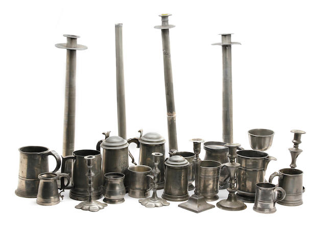 A quantity of pewter measures and candlesticks