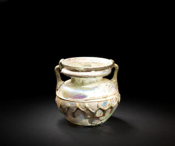 A Roman green-glass jar