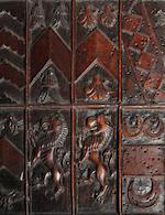 A fine late Elizabethan carved walnut armorial plaqueCirca 1601