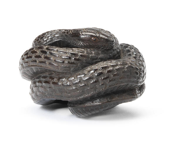 A kurogaki wood netsuke of a snake By Masanao, Ise, 19th century