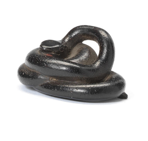 A rare ebony netsuke of a snake By Deme Taiman, early 19th century