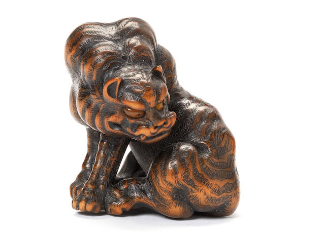 A fine large wood netsuke of a tiger By Naito Toyomasa (1773-1856), Tanba, early 19th century