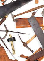 A large collection of antique woodworking tools