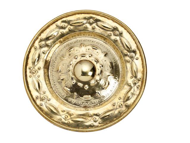 A 17th century style Flemish brass alms dish