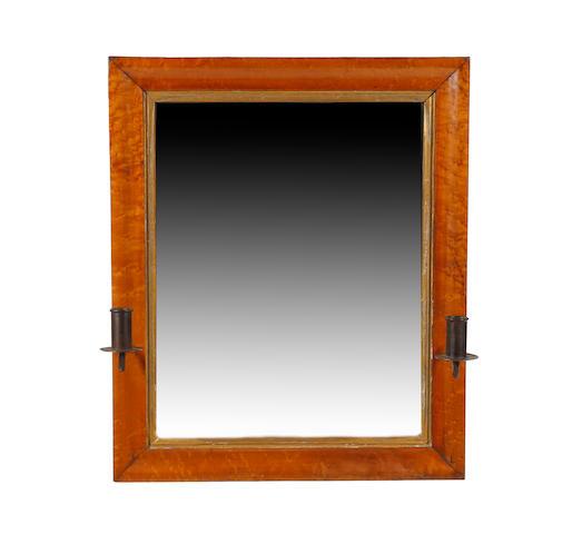 A bird's eye maple-framed wall mirror