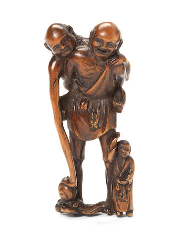 A wood netsuke of Tenaga and Ashinaga By Ittan, Nagoya, 19th century