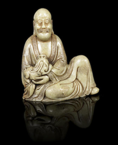A stone figure of a seated Luohan