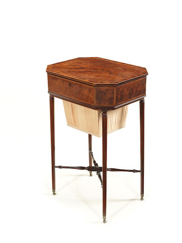 A George III mahogany and boxwood line work table
