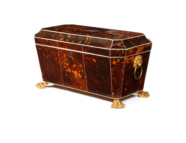 A Regency tortoiseshell veneered three division tea caddy