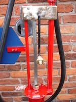 A finely restored model 281 Gilbert & Barker hand operated petrol pump