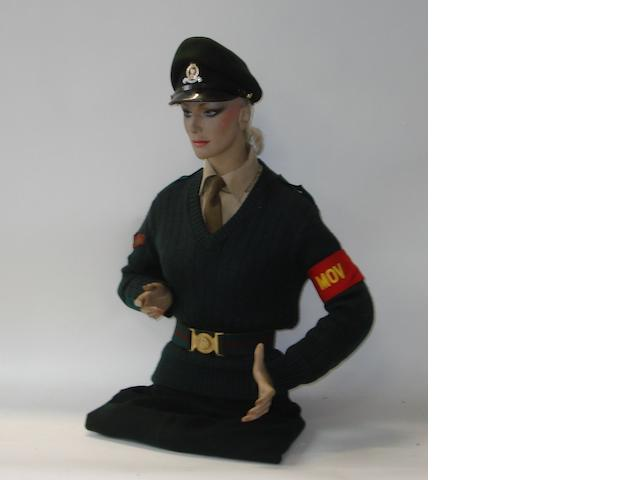 A half mannequin dressed as a Women's Royal Army Corps driver,