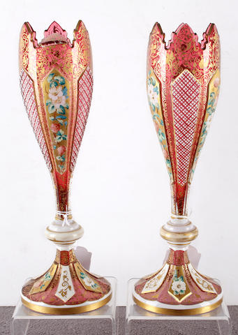 A pair of Bohemian overlay ruby glass vases