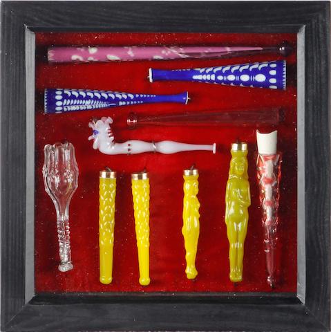 Eleven framed glass cigarette and cheroot holders