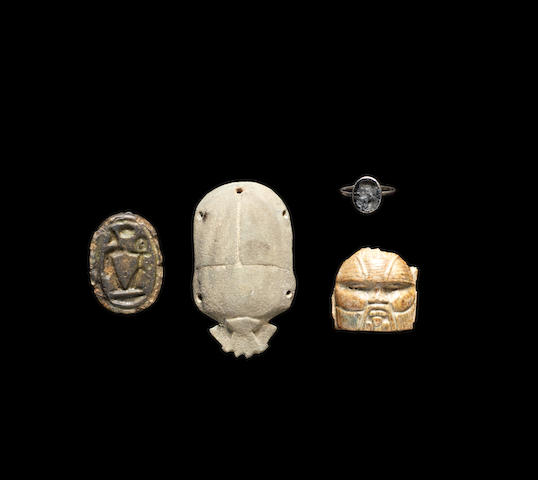 Three Egyptian Antiquities and a Roman glass intaglio, 4