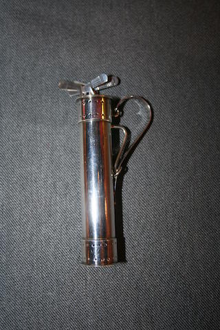 A sterling silver golf bag holding 6 silver cocktail sticks