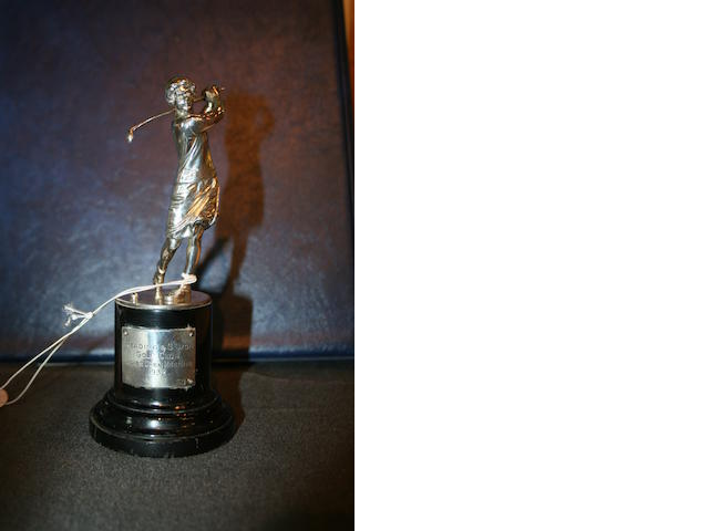 A solid silver golfing trophy of a Lady golfer with golf club circa 1930s