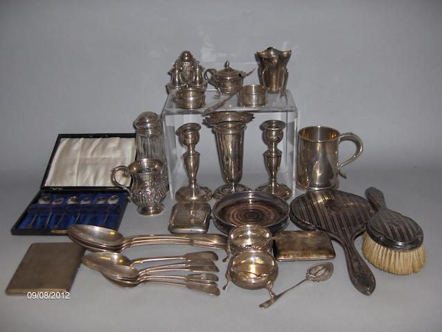 a pair of silver cushion salts, two christening mugs, three cigarette cases, flatware, condiments, napkin rings, etc, 44oz of weighable silver