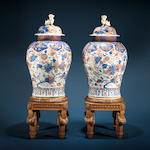 A very fine pair of Chinese Imari jars and covers Circa 1710-1730, on 19th century carved walnut stands in the Louis XVI style