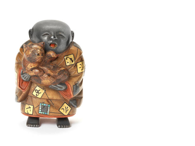 A lacquered netsuke of a boy Late 19th century