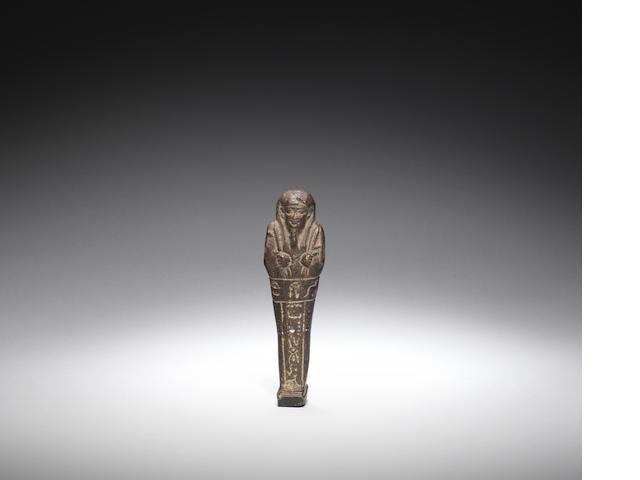 An Egyptian blackened glazed composition shabti