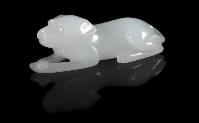 Small mutton fat jade figure of a dog lying down. 19th century