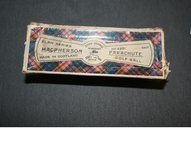 A MacPherson Clans Series Parachute Golf Ball in tartan box