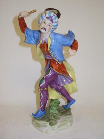 A Volkstedt figure of a harlequin