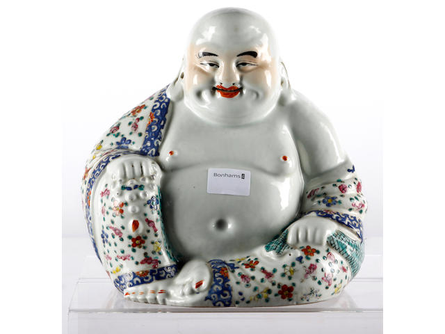 A famille rose porcelain figure of a Buddha and three snuff bottles