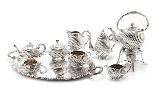 A late 19th / early 20th century Austro-Hungarian silver eight-piece tea and coffee service, together with a silver two-handled tray most pieces with maker's mark ES, possibly for Eduard Steiter, also some pieces with marks for Eduard Friedmann, with third standard mark, Vienna  (10)