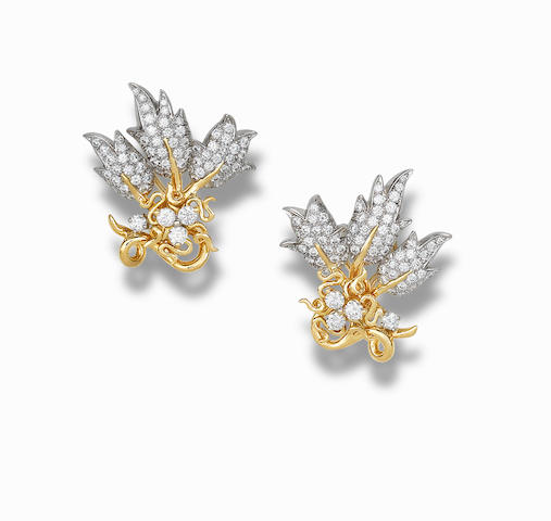 A pair of gold and diamond ear clips