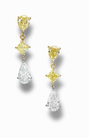 A pair of coloured diamond and diamond ear pendants