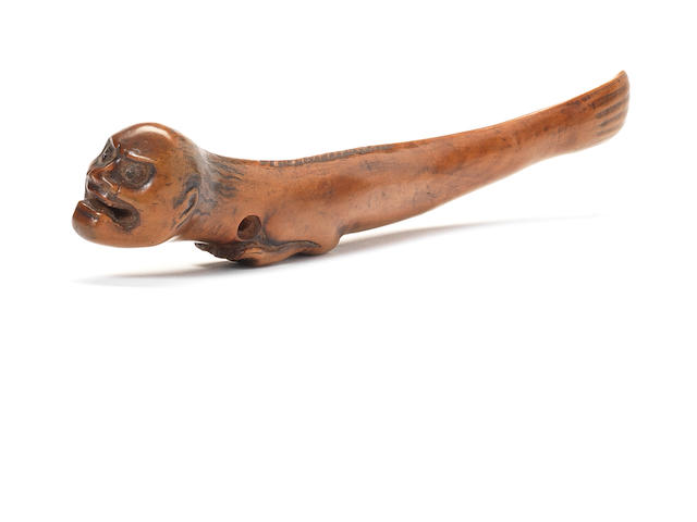 An unusual wood sash netsuke of a merman 19th century