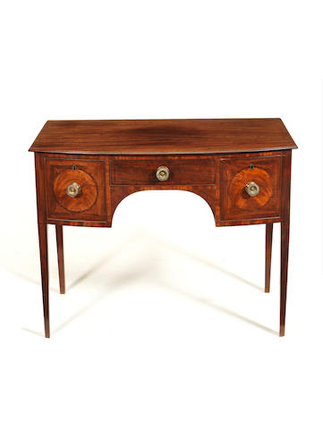 A small late George III mahogany crossbanded bowfront side table