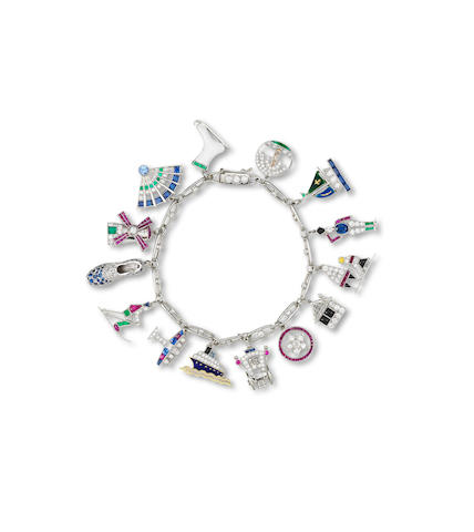 A multi-gem and diamond charm bracelet