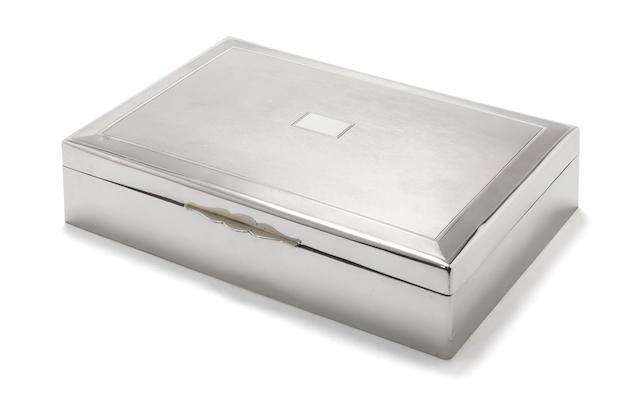 A large metalware cigarette box incuse mark 900