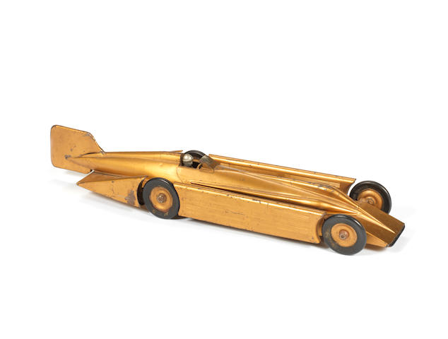 A Kingsbury tinplate Golden Arrow world speed car, 1929