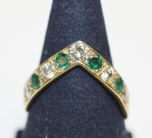 A wishbone emerald and diamond ring,