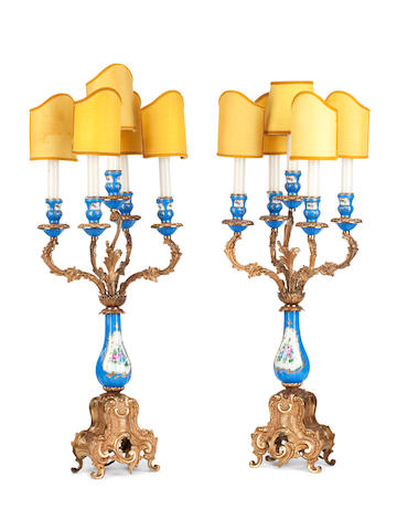 A pair of early 20th century ormolu and porcelain mounted five light candelabra
