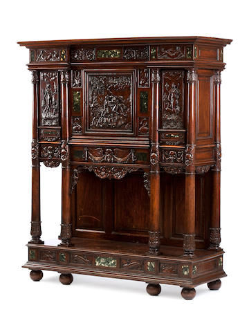 A 19th Century North European carved walnut and marble inset side cabinet