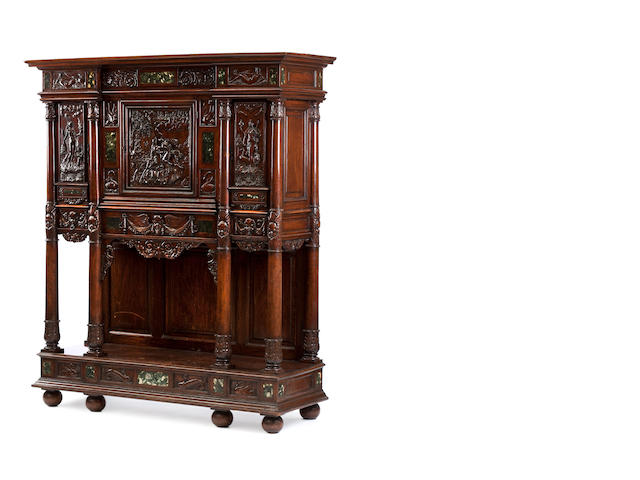 A North European carved walnut and marble inset side cabinet