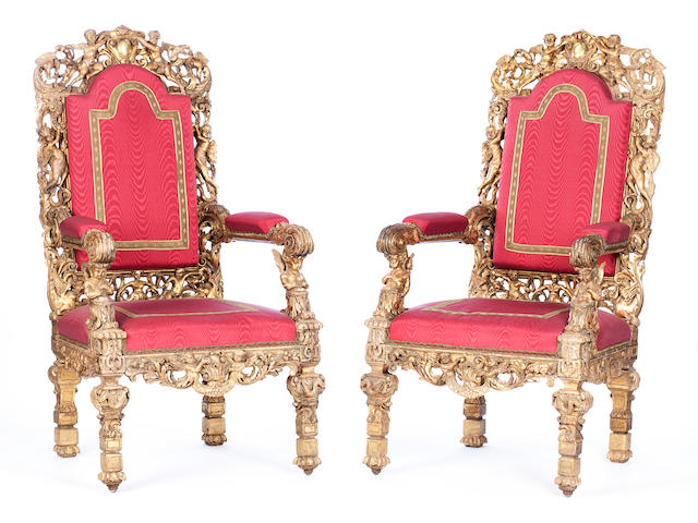 A pair of Italian 19th century giltwood and parcel gilt throne chairs