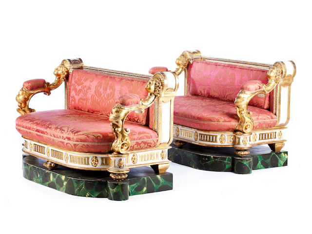 A pair of Italian mid-19th century giltwood and painted setteesIn the Baroque style