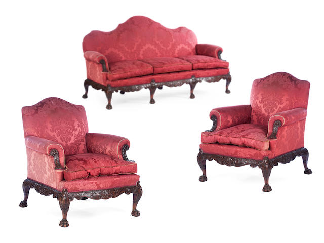 A George II style mahogany three seater settee and pair of armchairs