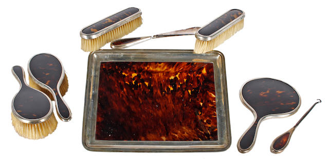 A silver mounted and tortoiseshell dressing table set with tray Mappin and Webb, London, 1923  (8)