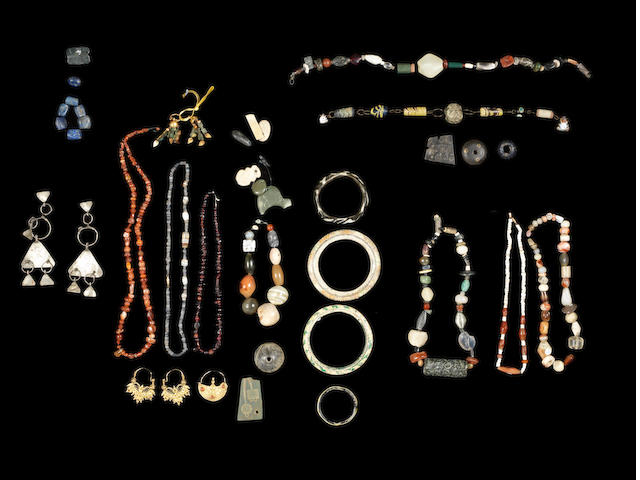 A group of Western Asiatic, Roman and later beads and a group of glass beads and other items, a lot