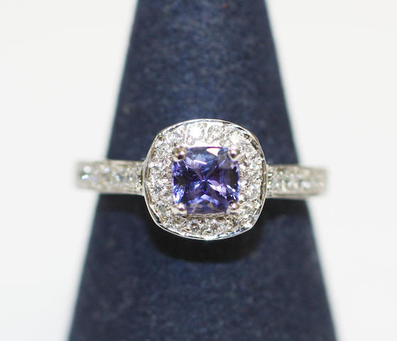 An 18ct white gold tanzanite and diamond cluster ring