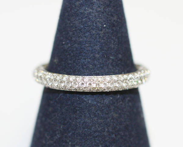 A diamond full-hoop eternity ring,