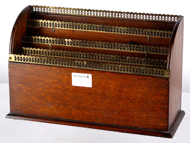 A Victorian oak letter rack,